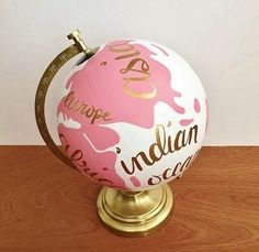 This custom hand painted world globe would make a beautiful display piece in your home, office, nursery or as a gift to a fellow travel lover. It is painted pink and white and the continents and oceans are hand lettered in gold. The dimensions are approximately 12 x 9 with the globe itself being 8 in diameter.  If you would like a different color scheme just let me know and I would be happy to customize it.  **Please allow 2-3 weeks before the globe is ready to ship**  Follow links below for…