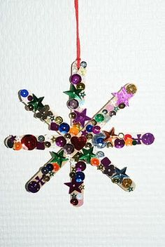 Popstick stars decorated with sequins and/or glitter