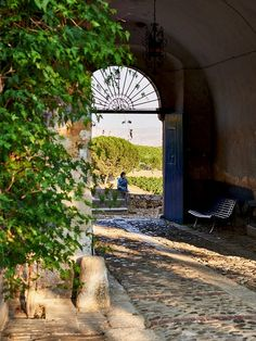 The entrance of Tasca d'Almerita's 1,250-acre Regaleali estate, which teems with organic vineyards, olive groves, fruit trees, and rose gardens. (All produce is available for purchase on-site.)