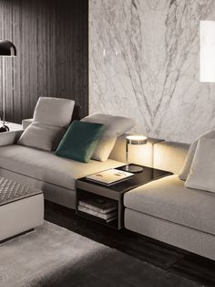 """The Yang sofa by Minotti is one of the innovations shown at the Salone del Mobile Milan 2015, by the Italian company,leader in made in Italy design. The Yang sofa is a creative idea by designer Rodolfo Dordoni, an original seating systemwith dynamic character that is intended for a young public. The Yang sofa is delineated by soft volumes and by anunconventional game of solids and voids. The distinctive feature of this system are the sophisticated stitching """"Cambre""""that offer added…"""