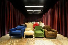 This is from Google's office, but a great idea of mismatched chair for a home movie theater.