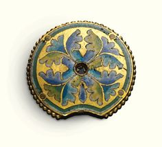 GERMAN, COLOGNE, AROUND 1180  PLAQUETTE IN THE FORM OF A NIMBUS champlevé enamelled copper