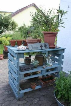 Garden shelf made from pallets. This kind of thing would be brilliant in my garden as it would be too high for the rabbits to get my plants!
