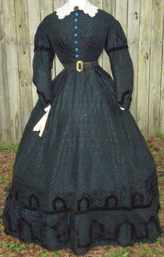 "Magnificent Civil War Era Day Dress C 1865 | eBay seller sadira33610; blue & black silk brocade, piped armholes, waist & neck; sleeves have puffed jockeys over narrower coat sleeves; original silk-covered dome button fastening; skirt fasted at left side-back; velvet trimming; bust: 36""; waist: 26"""