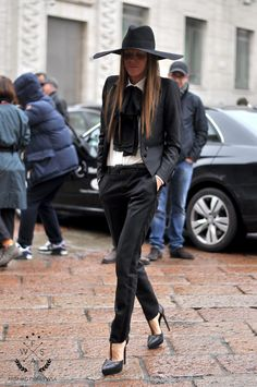 Anna Dello Russo..... It reminds me of the old creepy whistling guy on poltergeist 3!!!!