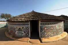 """"""" AN NDEBELE HOUSE PAINTING In the century, the Ndzundza Ndebele people of South Africa created their own tradition and style of house painting. Ndebele houses are painted by women as part of their girlhood initiations. Art Et Architecture, Vernacular Architecture, African House, Afrique Art, Natural Building, House Paint Exterior, African Culture, Traditional House, House Painting"""