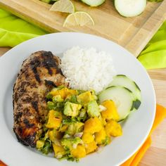 This easy Jerk Grilled Chicken with Mango Avocado Salsa is gluten-free, paleo, and under 300 calories!