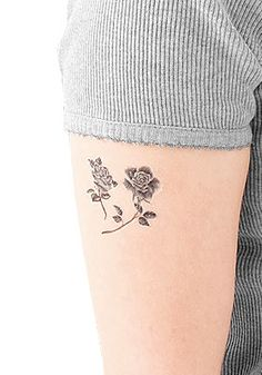 a small rose tattoo like this would be perfect!