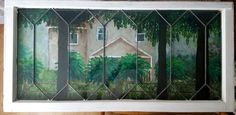 Oil Painting of our family home placed behind an antique lead glass window and placed on our wall. It looks like your looking out the window at our home.