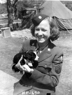 Women's Army Corps (WAC) Technician Ruby P. Hale Holds a Puppy