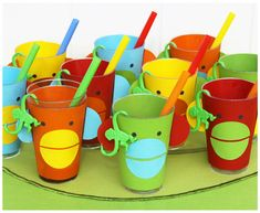 SOCK MONKEY PARTY- Monkey cups were made from construction paper by using circular paper punches, a hole puncher and scissors, then glued around clear plastic cups.