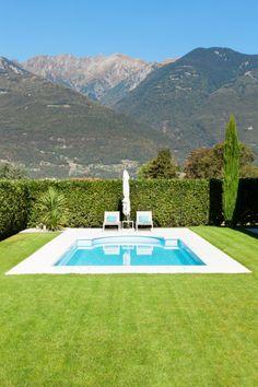 Light blue #pool with small white wrap-around patio