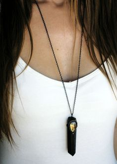 One necklace, featuring a large terminated black smoky quartz crystal point, set in an artistic handmade silver alloy solder setting, with a rainbow flash teardrop cut labradorite stone set in the center.  Gunmetal plated brass chain measures about 28 long, with a lobster clasp and a mother of pearl crescent moon accent. Pendant hangs about 3 long including the bail  You will receive the exact item pictured.