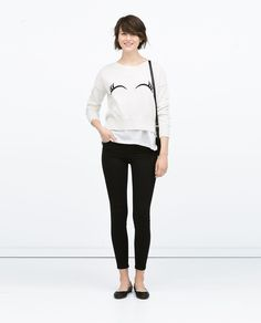 Image 1 of PLAIN KNIT UNEVEN HEM SWEATER WITH EYE EMBROIDERY from Zara
