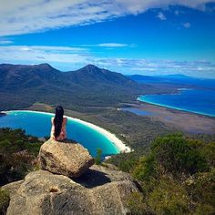 Quietly taking in the splendor of Mother Nature from the Mount Amos lookout in the heart of the Freycinet National Park. The white sands of Wineglass Bay below are consistently ranked as one of the best beaches in the world and offer countless opportunities to explore the pristine wilderness of the surrounding Freycinet Peninsula.