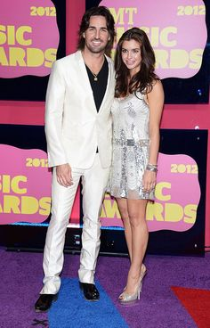 "Newly engaged ""Alone With You"" singer Jake Owen at the CMT 2012 Music Awards brought his gorgeous fiancée Lacey Buchanan as his date and the white-clad duo looked like they were ready to walk down the aisle … in Las Vegas."