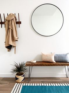 Sep 2018 - Round mirror entryway inspiration + how to re-create the look; Boho-chic, Mid-century modern and modern contemporary styles. Oversized Round Mirror, Round Mirrors, Black Round Mirror, Entryway Mirror, Modern Entryway, Boho Chic Entryway, Entry Foyer, Wall Mirror, Entryway Bench