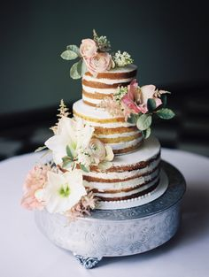 Two toned, three tier flower topped wedding cake: http://www.stylemepretty.com/2016/08/17/classic-pastel-pasadena-villa-wedding/ Photography: Winsome and Wright - http://winsomeandwright.com/