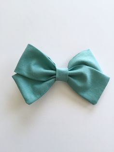 A personal favorite from my Etsy shop https://www.etsy.com/listing/273734312/teal-bowheadbandbaby-gift