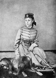 Frances M. A. Roe wearing her husband's West Point coatee, pictured with their dog.