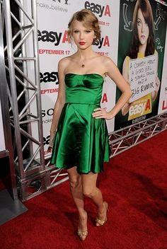 Taylor Swift looked youthful and fabulous in an emerald green Miu Miu mini.