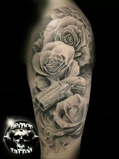 Black and gray roses and gun tattoo