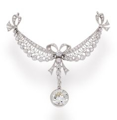 A belle époque diamond pendant, French, circa 1910  designed as a garland of old European and rose-cut diamonds with diamond bow detail and suspending an old European-cut diamond line with larger diamond terminal; with French assay mark; central diamond weighing approximately: 1.55 carats; mounted in platinum; width: 2 1/2in. (necklace deficient)