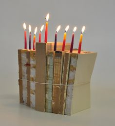 """No vintage books to make a menorah like this, stop by the Library's book sale and sponge with a wet tea bag to get that """"aged look"""""""