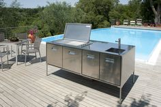 It's summer -- what better what to spend it than enjoying outside? Throw a pool party or BBQ with the help of Arclinea's Artusi Outdoor kitchen. Artusi Outdoor was specifically designed to withstand outdoor elements. The stainless steel and 4cm thick door with built-in insulation and magnetic seal aids in protecting the inside from insects and dust. Keep your food or drinks heated and cold with the deep internal Artusi draws.