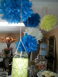 Kalestas 8th grade graduation party.hanging mason jars and flowers made from tissue paper.
