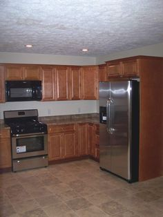 "KCK kitchen cabinets - A testimonial submitted by Submitted by SCOTT WILLIS : "" Were very happy with the cabinet quality and finished kitchen look, our organization looks forward to working with Kitchen Cabinet Kings on our future remodeling projects. """