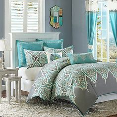 Bring a Bohemian chic look to your bedroom with the beautiful Madison Park Nisha Comforter Set. The stylish bedding is beautifully embellished with a dusty teal and lime green paisley pattern inside an ogee design on a charcoal grey ground.