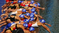 Triathletes ready for Hyde Park test - London 2012 Olympics.  The swim start!  I love this picture.