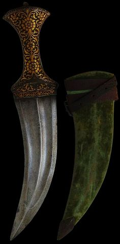 Indian (Mughal) Jambiya (curved dagger), 19th century, double-edged watered steel blade with double grooves, central ridge, waisted hilt entirely covered in gold overlay in floral and foliage patterns, the pommel is rounded and also decorated with gold overlay. The rounded pommel finial is also gilded, green velvet covered wooden scabbard has a metal chape and an attached leather belt band. length: 34cm, weight: 289g