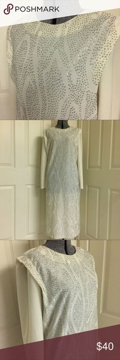 Plus-size VINTAGE glittered dress WHITE HOT! True vintage in rare plus-size! Show off your curves in this dazzling white dress covered in clusters of sparkling silver glitter! Slip-on style with single button closure at back of neck. GREAT condition, but there's minor wear (piling) on the underside of the sleeves. I had considered removing the long sleeves, but I will leave that decision to the new owner. Column style dress. Measurements in inches: length 46, bust 42-44, waist 44-46. Perfect…
