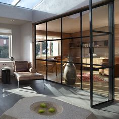 A sense of space is created in Butler Armsden Architects' remodel of a San Francisco William Wurster house with interior metal French doors that demarcate work and living space without cutting off light.