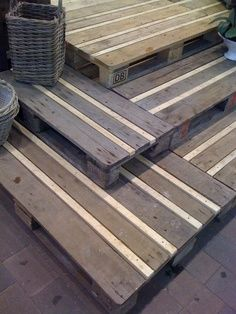 I love the striped look of these pallets! Wash the wood with a greyish-blue paint and then nail some skinny whitewashed boards in between to close in the gaps and make it more functional.