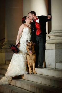 Pirate wedding picture on the steps of the Hippodrome State Theater in Downtown Gainesville, of course with our German Shepherd fur-baby & the bouquet that I made.