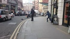 Incredible Moment: Man In Suit Takes On Thief With A Machete Ln London Street - PHOTOS - INFORMATION NIGERIA