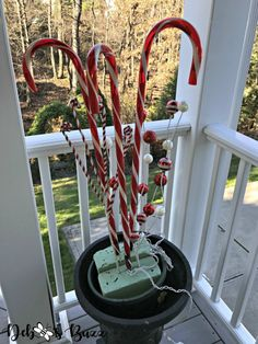 Learn how to create a whimsical pair of lighted candy cane Christmas urns. The easy, process includes illustrative photos and useful DIY tips. Diy Christmas Urns, Outdoor Christmas Light Displays, Diy Christmas Lights, Christmas Displays, Primitive Christmas, Christmas Treats, Outdoor Candy Cane Decorations, Christmas Candy Cane Decorations, Candy Cane Crafts
