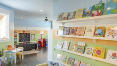 Help Your Kids Stay Organized This Summer | This playroom is features an awesome book gallery wall and plenty of ways to kids to stay organized as they play. At 5233 Stonegate Road.