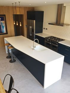 The kitchen used Rational units, an arctic ice Corian worktop, a seamless corian sink, brick tile splashback and stainless steel fittings and appliances