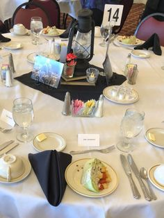 BHC/LRS Award Lunch 2018, Lantern on books with glass votives with flowers and a candle, resp.