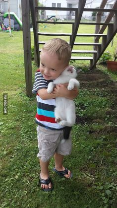 His first time holding a kitten. Kitty was not amused.