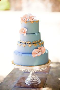 Light blue wedding cake with pale peach flowers. Pretty Please Bakeshop.