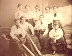 This picture is really cool!  Ca. 1877 image of a women's baseball team - their uniforms are white shirts with long, dark skirts.  Three of the nine women are holding baseball bats.  (Oshkosh Public Museum)