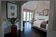 Beautiful bedroom with a wall of windows, great hardwood floors, and a fireplace...LOVE IT!