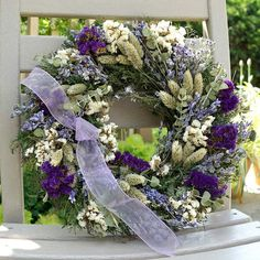 Twilight blue, French-wire ribbon sets off this flower garden of a wreath.