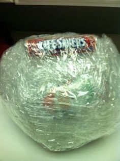 Candy Ball Game for big kids – jingle bell at the center, wrap with layers of bubble wrap, candy, packing plastic, tape. To play – kids in circle, one kid tries to unwrap candy till another kid rolls doubles with dice, pass to the left for another turn. Rolling doubles with the dice acts as a timer for each turn. | best stuff