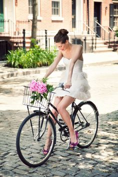 Brighten Up in White Dresses I love this short dress with a cute idea: flower on bycle :)